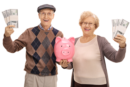 senior couple with bundles of money